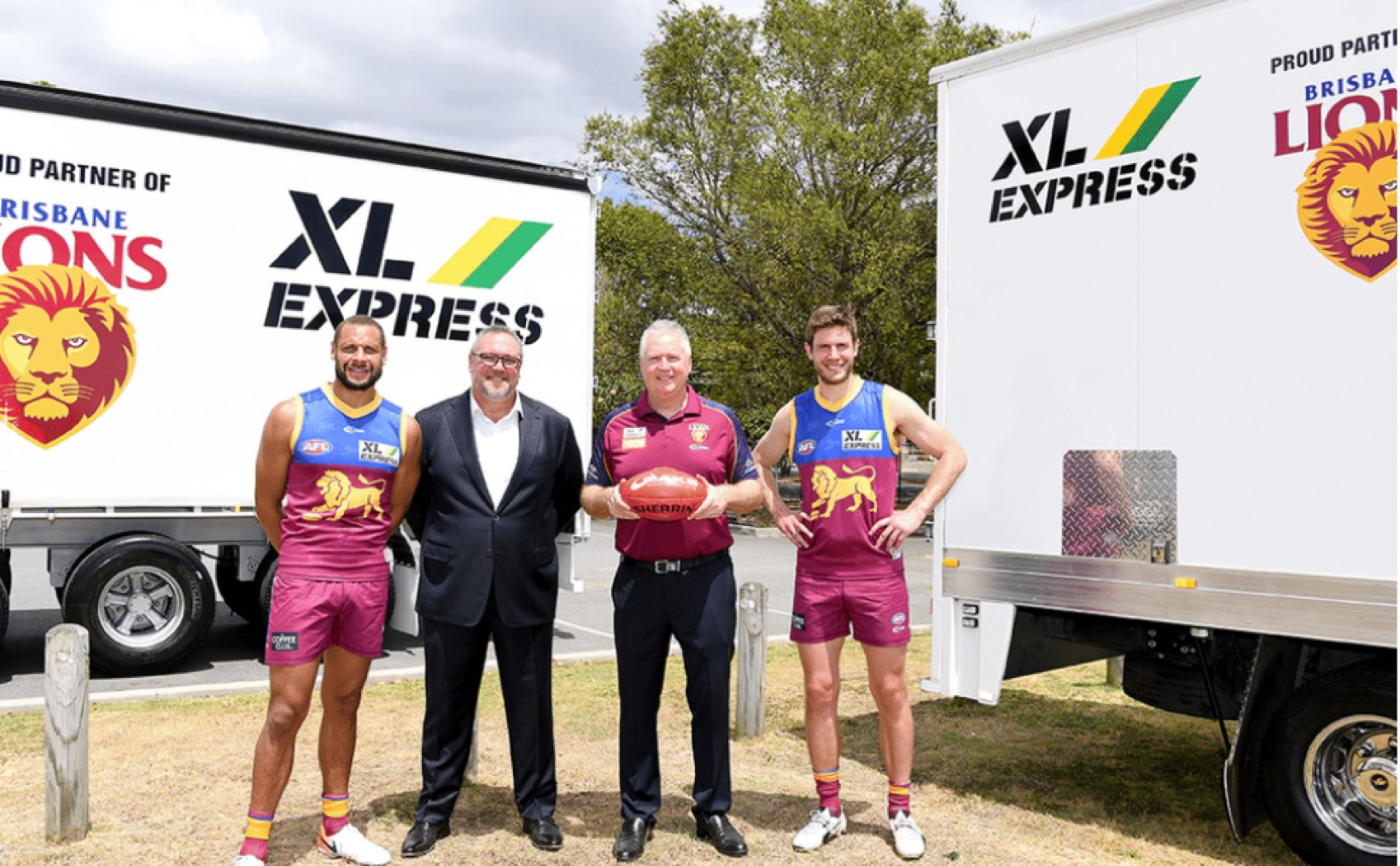 Brisbane Lions AFL football players with XL Express sponsorship team
